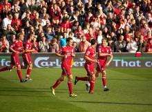 Liverpool players celebrate vs Bolton, Danny Molyneux